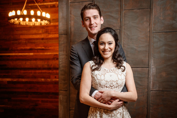 Emi and Alex pose for a wedding portriat at Ovation in Chicago's west loop