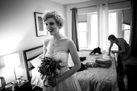 Lesbain bride look in the mirror before her Chicago wedding